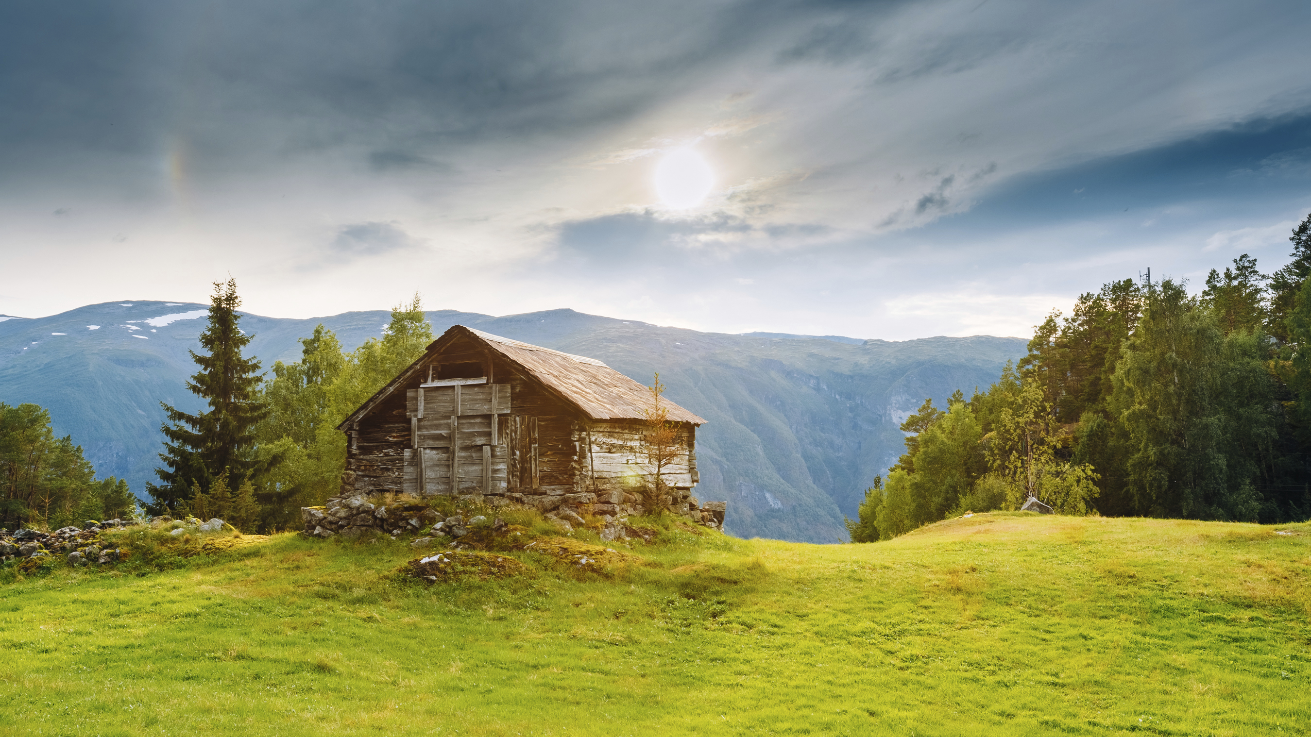 Old abandoned wooden house on a background of the Norwegian moun